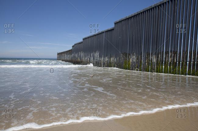 Mexican border wall on beach