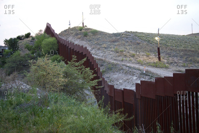 Mexican border wall on a hill
