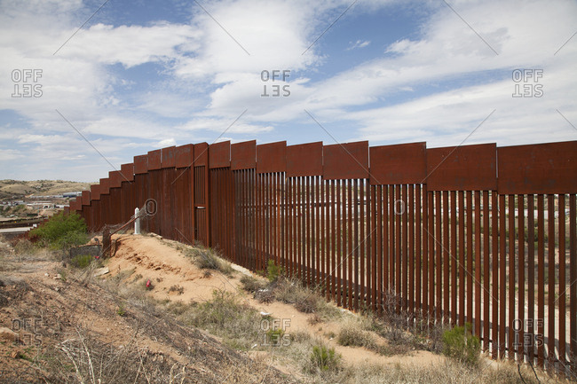 Mexican border wall in rural setting