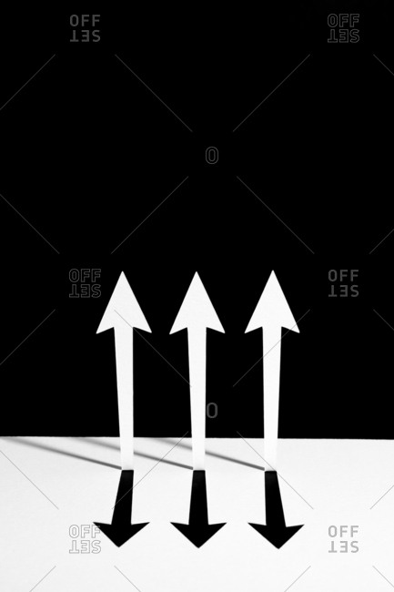 White arrows pointing up on a black background