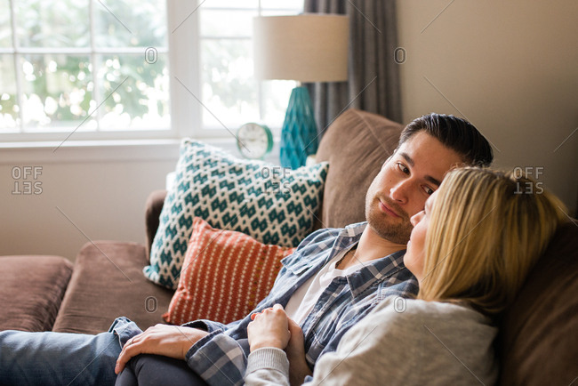 Man gazing at woman on couch