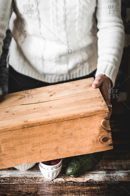Person holding rustic wooden box