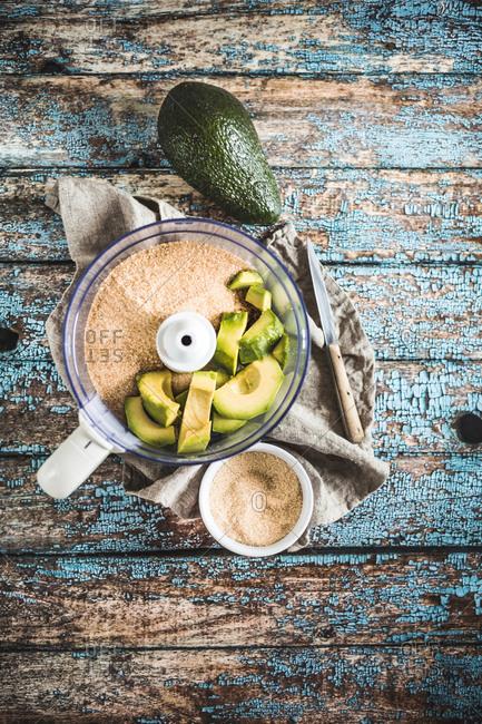 Avocado in food processor with sugar for cake recipe