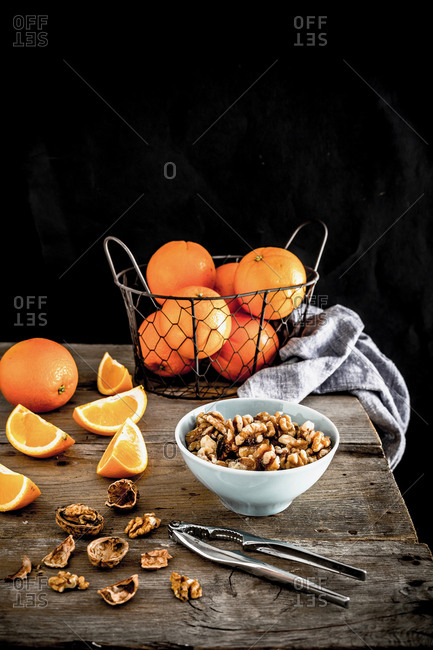 Still life of oranges with walnuts
