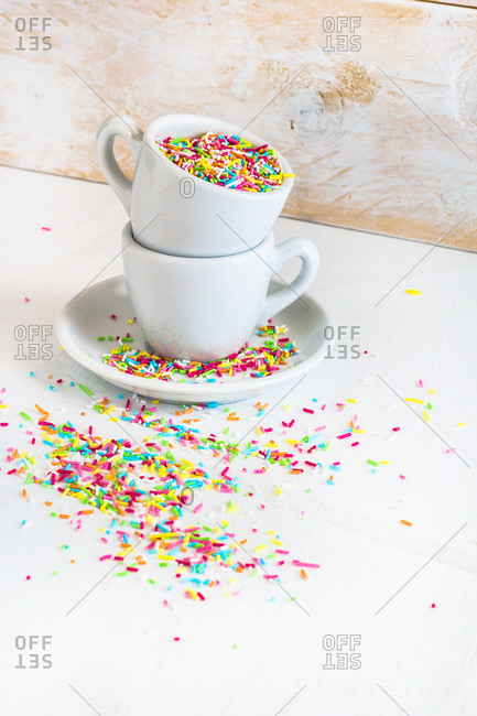 Cups full of multicolored sprinkles