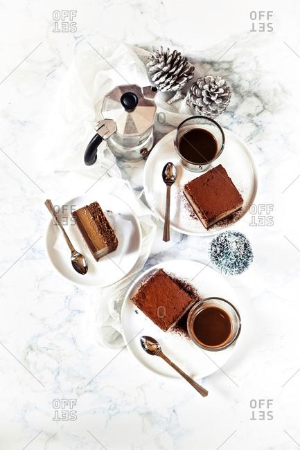 Chocolate cake squares served with espresso