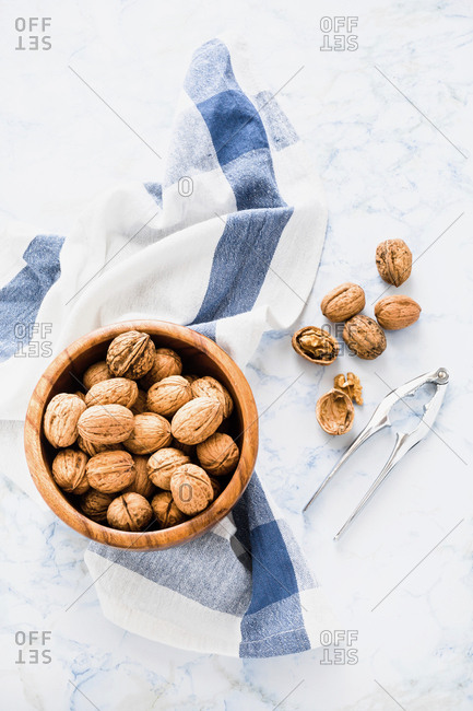 Wooden bowl of walnuts
