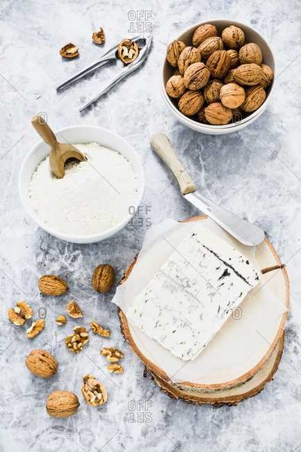 Walnuts and wedge of blue cheese