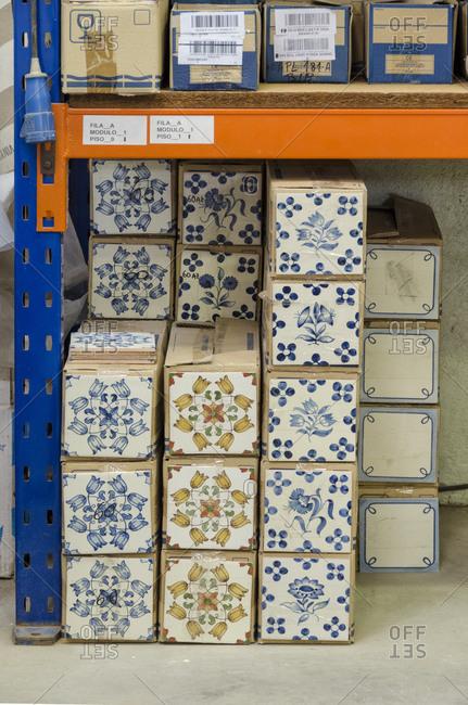 Lisbon, Portugal - February 19, 2014: Traditional ceramic tiles on a shelf