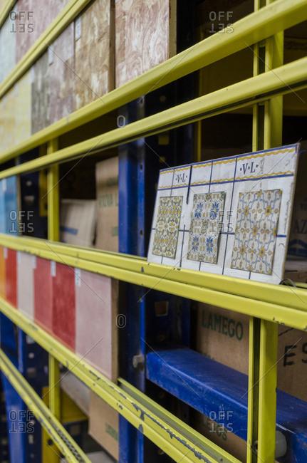 Lisbon, Portugal - February 19, 2014: Sample tile patterns on shelf