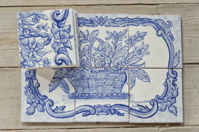 Lisbon, Portugal - March 18, 2014: Painted tile pieces arranged in pattern