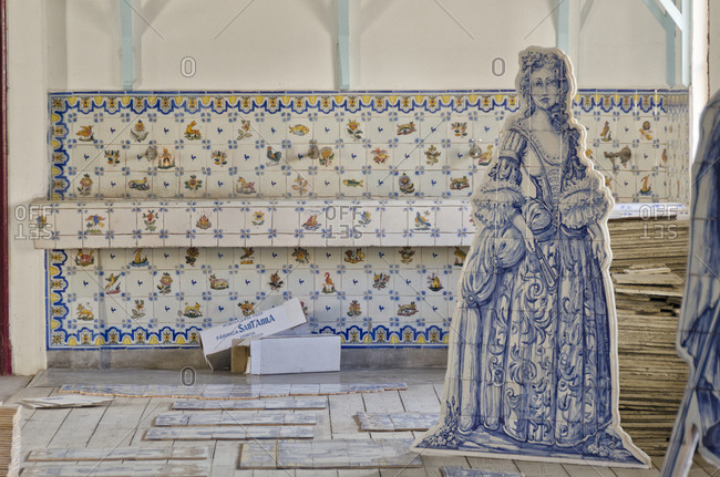 Lisbon, Portugal - March 18, 2014: Ceramics in factory with historic figures