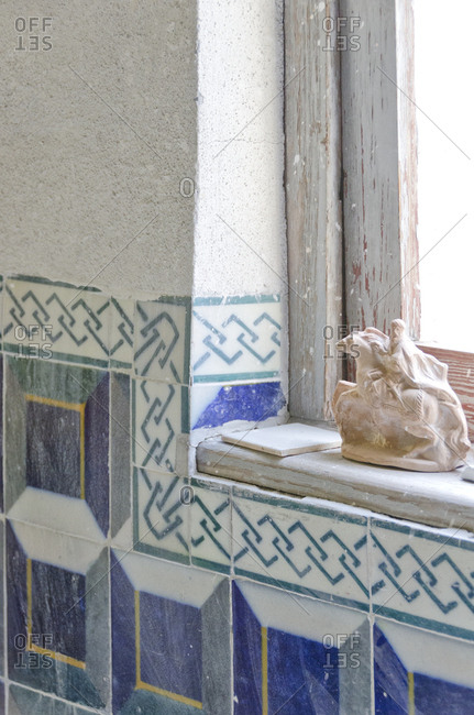 Lisbon, Portugal - March 18, 2014: Ceramic figurine on window