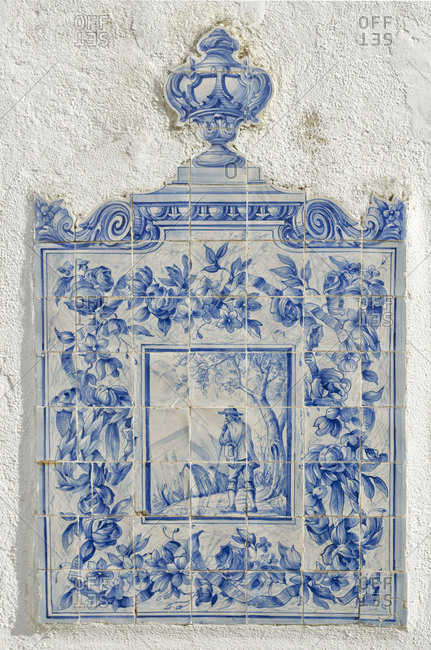 Lisbon, Portugal - March 18, 2014: Historic sconce on traditional tile
