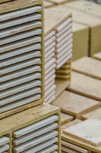 Tiles in storage containers in factory
