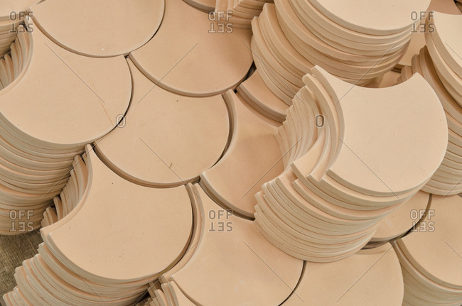 Rounded tiles in a factory