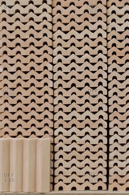 Stacks of ceramic tiles in factory