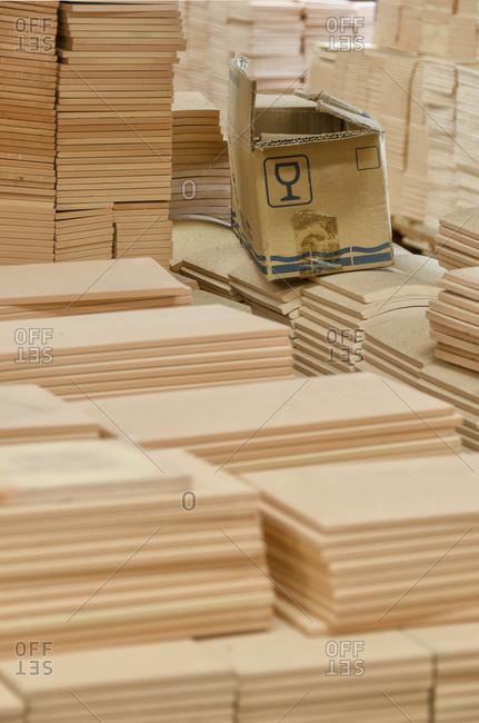 Stacks of plain tiles in warehouse