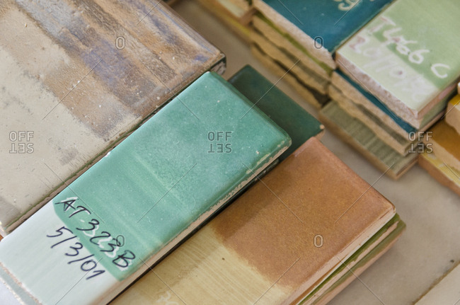 Close up of painted tiles with labels