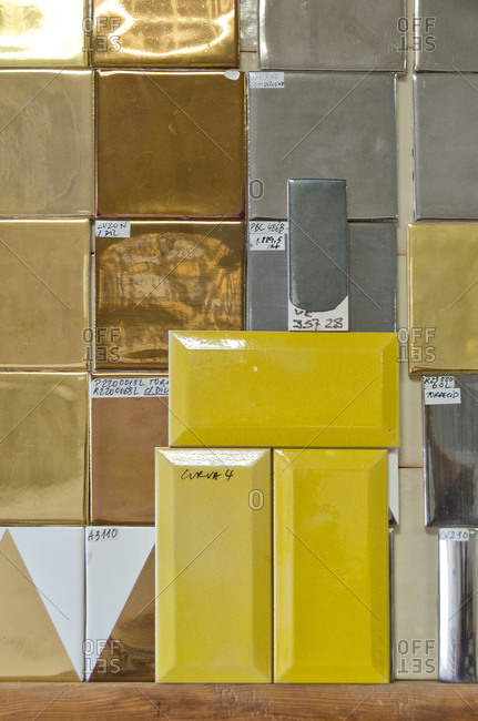 Various painted tiles with labels