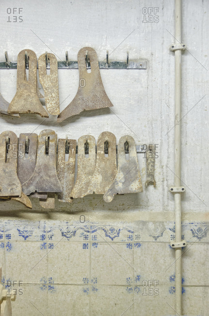 Tools hanging on wall in tile factory