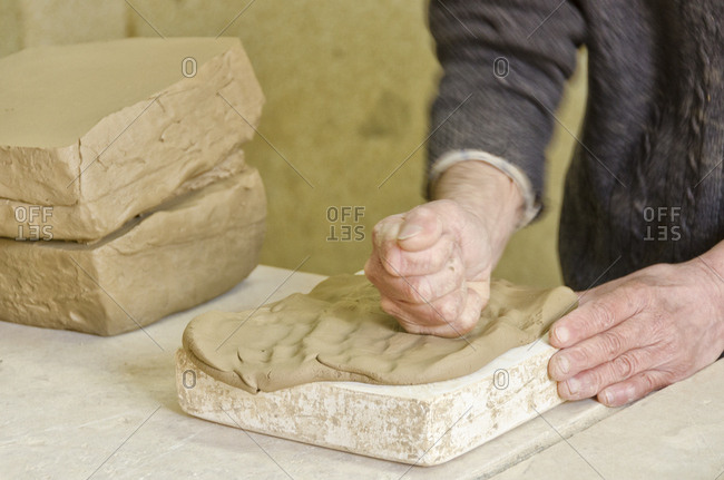 Person filling mold with ceramic