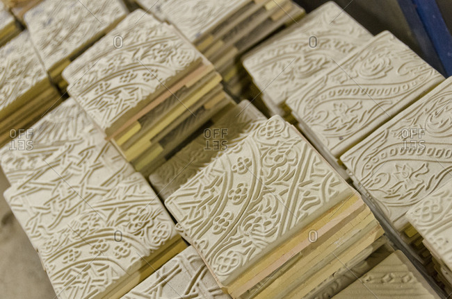 Close up of tiles made from molds