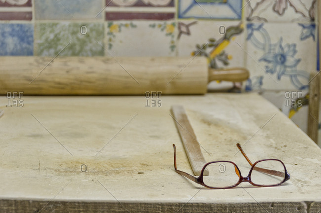 Glasses on workbench in tile factory