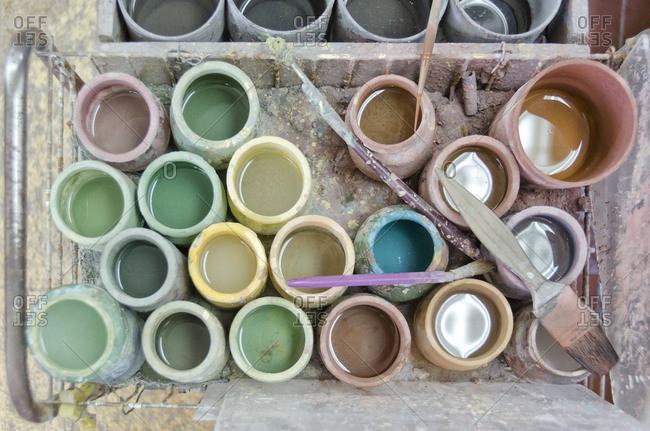 Paints and brushes in tile factory