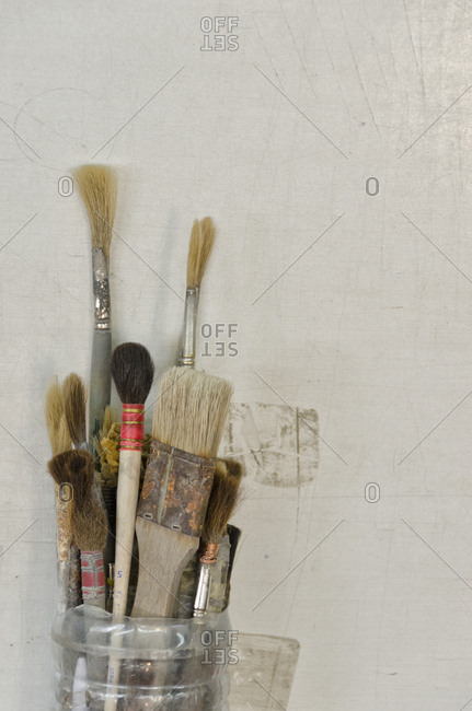Various paintbrushes in a container