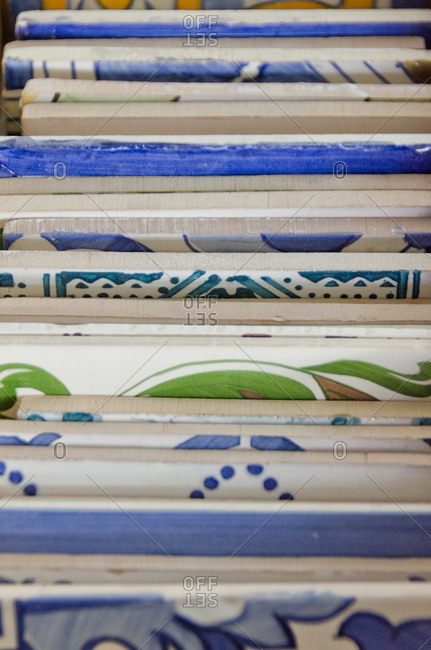 Variety of painted tiles in factory