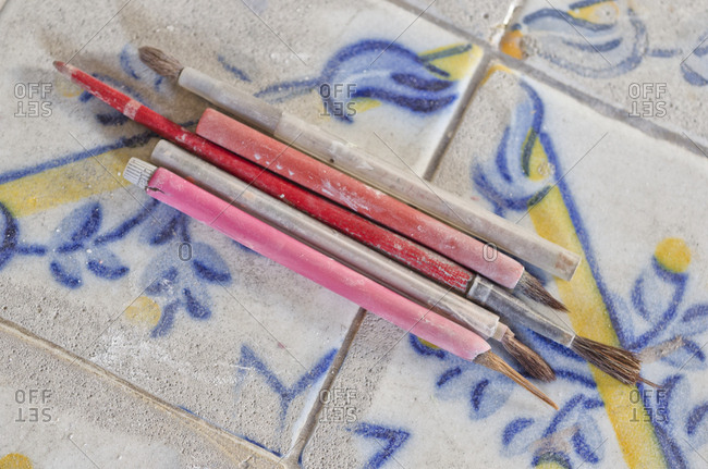 Brushes on painted tile in factory
