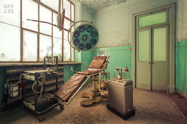 Racconigi, Italy - February 7, 2016: Old operating room in abandoned hospital