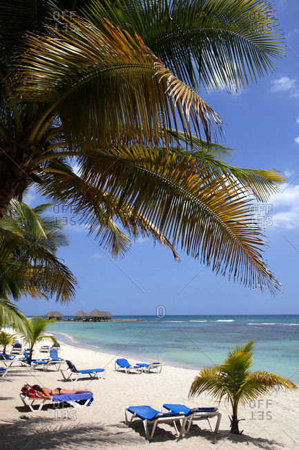 Caribbean- Dominican Republic- palm beach and sun loungers
