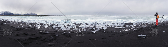 Iceland- Jokulsarlon- Diamond Beach- photographer at work on the beach