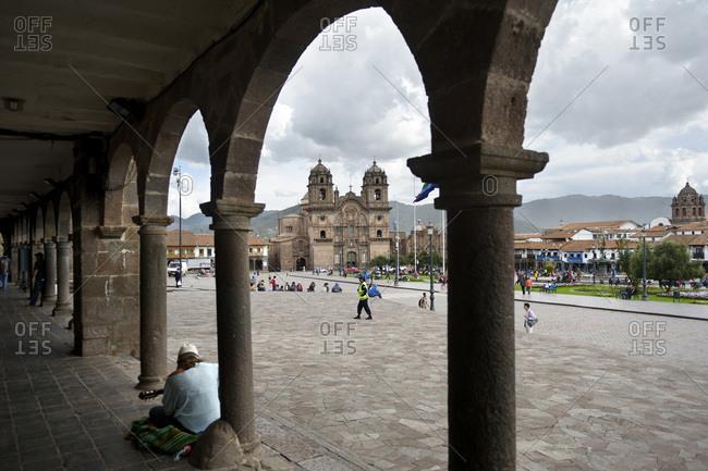 Peru, Cusco - February 28, 2016: Plaza de Armas with Jesuit Church and arcade