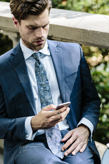 Businessman using smart phone- close up