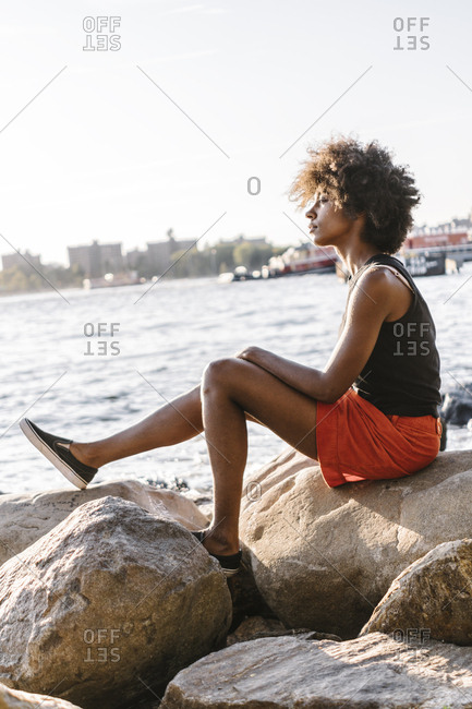 Young woman in Brooklyn sitting at East River