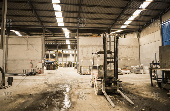 Forklift in factory messy hall