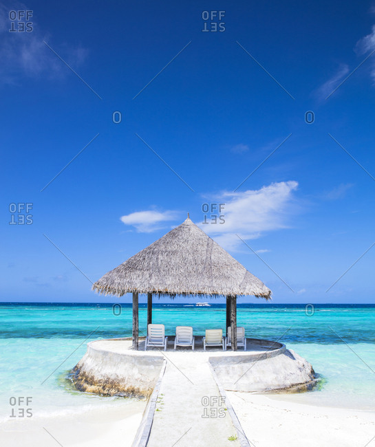 Maldives-South Male Atoll- Sun loungers under parasol
