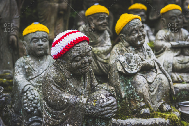 Japan- Miyajima- Danish-In Temple- stone Buddha's with crocheted skullcaps
