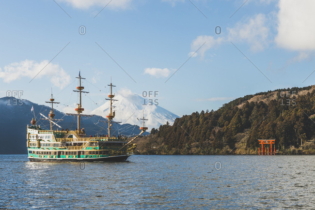 Japan, Hakone - January 9, 2017: Tourist boats on Lake Ashi Mount Fuji in background