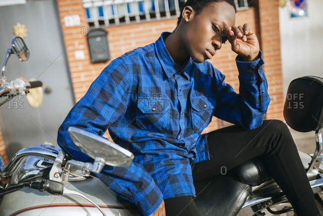 Young woman on motorbike