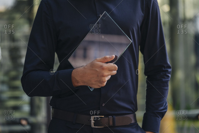 Businessman holding futuristic portable device