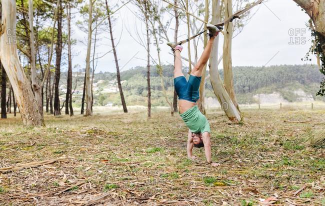 Man doing suspension training outdoors