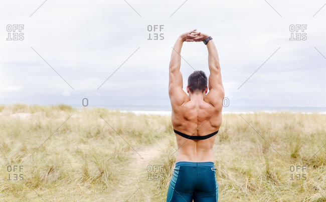 Bare-chested man exercising outdoors