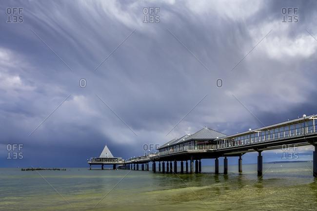 Germany- Usedom- Heringsdorf- cloudy sky over sea bridge