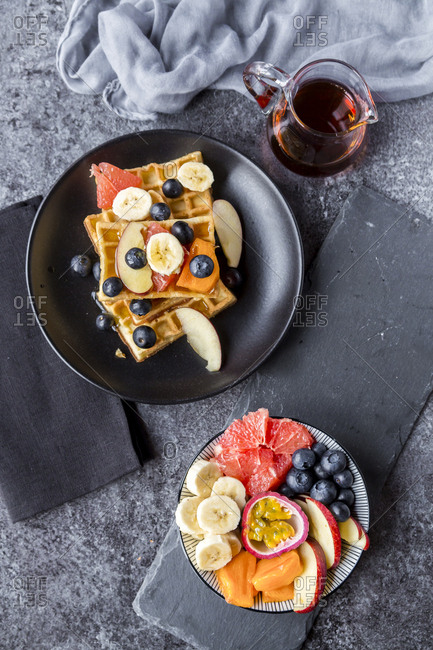 Waffles with various fruits and maple syrup