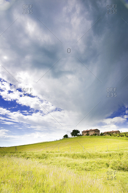 Italy- cloudy sky over houses on a hill