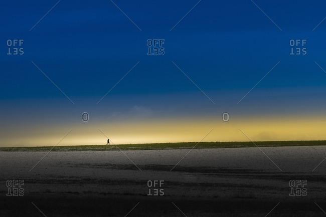 Silhouette of man at horizon